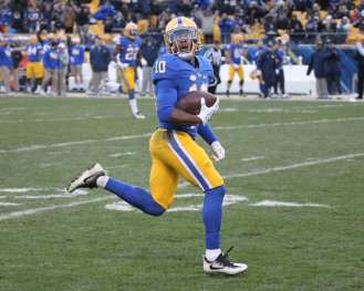 Quadree Henderson looks back as he runs in for a touchdown (Photo by: David Hague)
