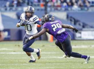 Quadree Henderson #10 of the Pittsburgh Panthers stiff arms Trae Williams #29 of the Northwestern Wildcats after making a catch. The Northwestern Wildcats defeated the Pittsburgh Panthers 31-24 in the 2016 New Era Pinstripe Bowl at Yankee Stadium on Wednesday, December 28, 2016.