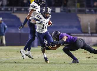 Quadree Henderson #10 of the Pittsburgh Panthers breaks a tackle late in the game. The Northwestern Wildcats defeated the Pittsburgh Panthers 31-24 in the 2016 New Era Pinstripe Bowl at Yankee Stadium on Wednesday, December 28, 2016.