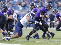 Ejuan Price #5 of the Pittsburgh Panthers sacks Clayton Thorson #18 of the Northwestern Wildcats. The Northwestern Wildcats defeated the Pittsburgh Panthers 31-24 in the 2016 New Era Pinstripe Bowl at Yankee Stadium on Wednesday, December 28, 2016.