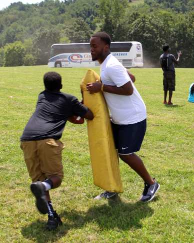 Pitt Freshman run a mini football clinic at the Mel Blount Youth Leadership Initiative (Photo by David Hague)
