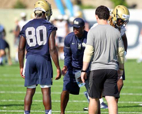 Coach working with Dontavius Butler-Jenkins August 1, 2017 (Photo by David Hague)