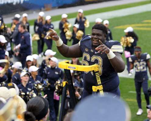 Alex Officer (63) Directs the band after Pitt win October 28, 2017 -- David Hague