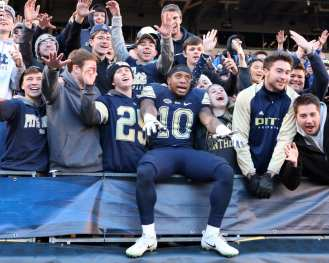 Quadree Henderson (10) celebrates with the Pitt Student Section November 24, 2017 -- DAVID HAGUE/PSN