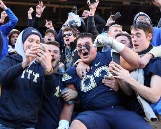 Shane Roy (93) celebrates with the Pitt Student Section November 24, 2017 -- DAVID HAGUE/PSN