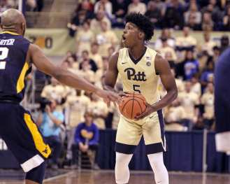 Marcus Carr (5) calls out the play as the Pitt Panthers take on West Virginia on December 9, 2017 -- DAVID HAGUE