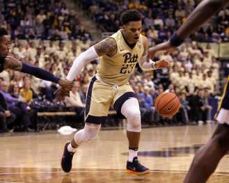 Shemiel Stevenson (23) dribbles past WVU defense as the Pitt Panthers take on West Virginia on December 9, 2017 -- DAVID HAGUE