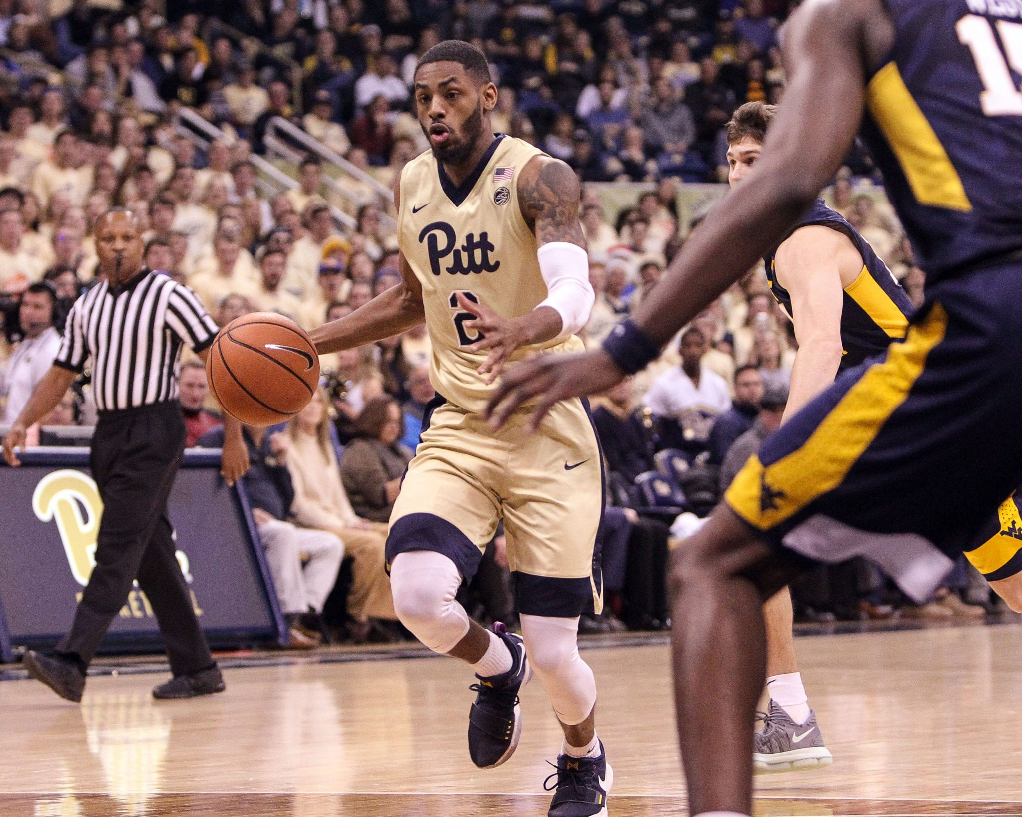 Jonathan Milligan (2) drives to the basket as the Pitt Panthers take on West Virginia on December 9, 2017 -- DAVID HAGUE