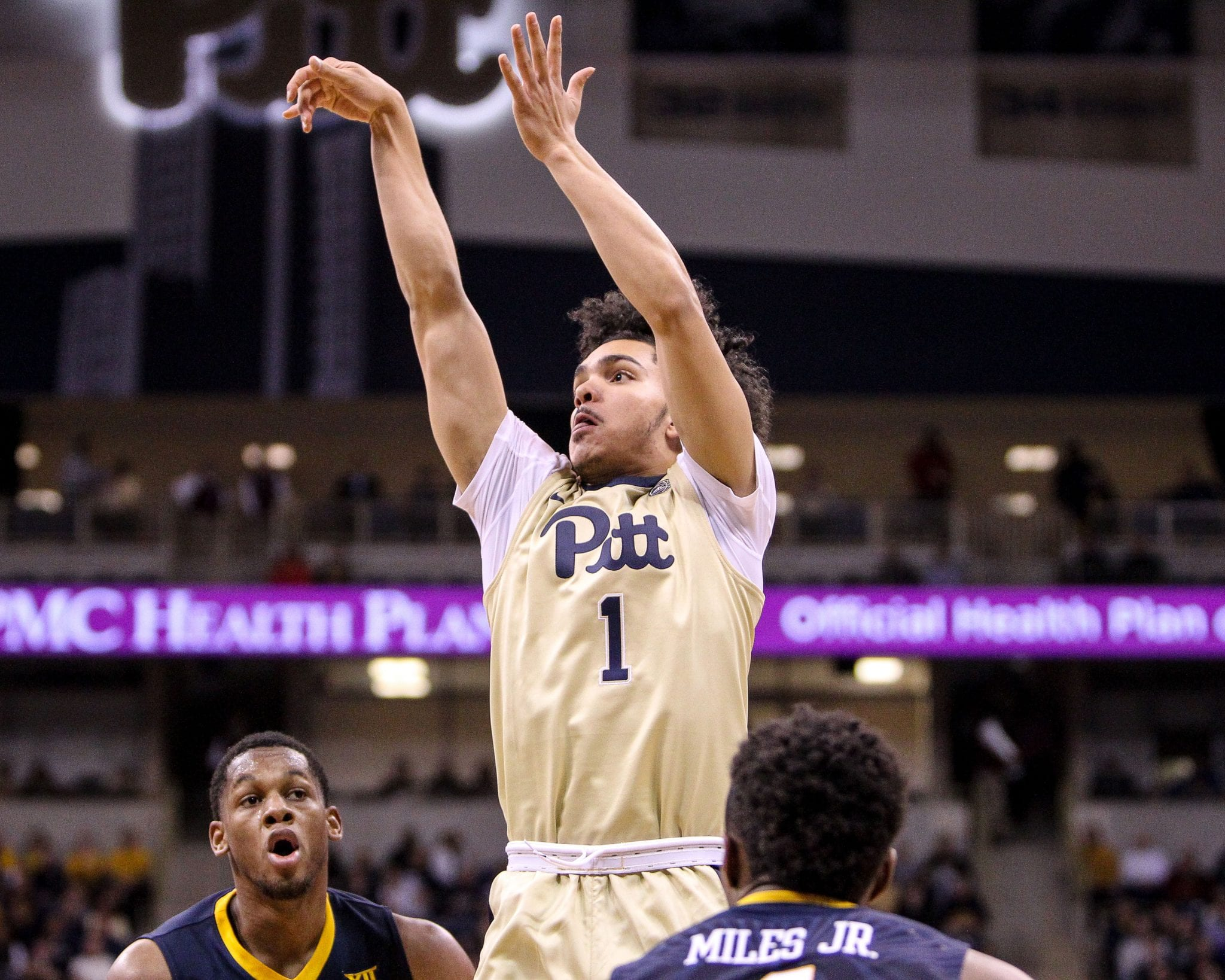 Parker Stewart (1) shots a 3 pointer as the Pitt Panthers take on West Virginia on December 9, 2017 -- DAVID HAGUE