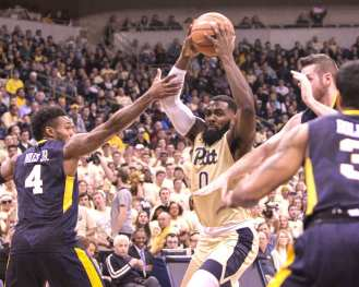Jared Wilson-Frame (0) drives the lane as the Pitt Panthers take on West Virginia on December 9, 2017 -- DAVID HAGUE