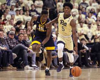 Marcus Carr (5) brings the ball up court as the Pitt Panthers take on West Virginia on December 9, 2017 -- DAVID HAGUE