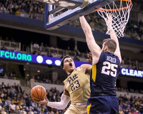 Shemiel Stevenson (23) tries to dunk over Maciej Bender (25) of West Virginia as the Pitt Panthers take on West Virginia on December 9, 2017 -- DAVID HAGUE