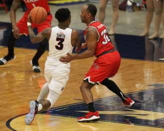 Tarin Smith (3) drives to the hoop against Joey Frenchwood (32) as the Duquesne Dukes took on Lamar December 19, 2017 -- DAVID HAGUE