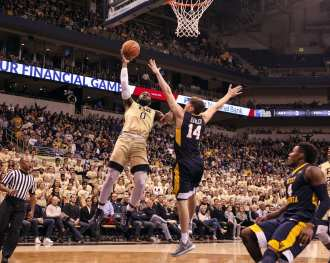 Jared Wilson-Frame(0) goes in for the layup as the Pitt Panthers take on West Virginia on December 9, 2017 -- DAVID HAGUE