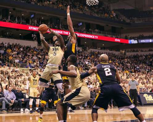 Marcus Carr (5) tries for the layup as the Pitt Panthers take on West Virginia on December 9, 2017 -- DAVID HAGUE