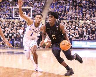 Marcus Carr (5) against Duke on January 10, 2018 -- DAVID HAGUE