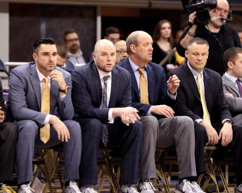Coach Kevin Stallings and assistants look on in the late minutes against Syracuse on January 27, 2018 -- DAVID HAGUE