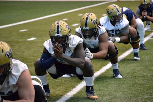 Pitt players stretching.