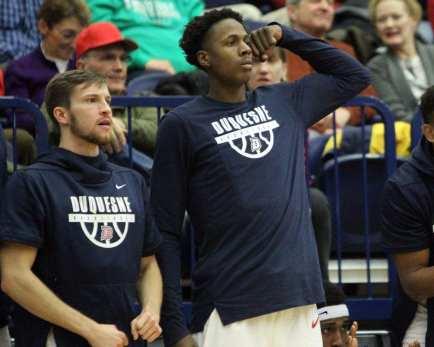 Duquesne Bench reacts to a dunk December 5, 2018 -- David Hague/PSN
