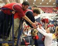 Coach Keith Dambrot celebrates with students January 12, 2019 -- David Hague/PSN