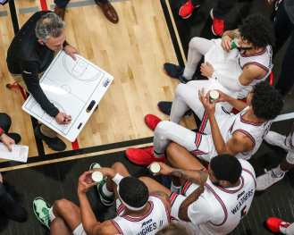 Keith Dambrot and team during a time out January 9, 2021 Photo by David Hague/PSN