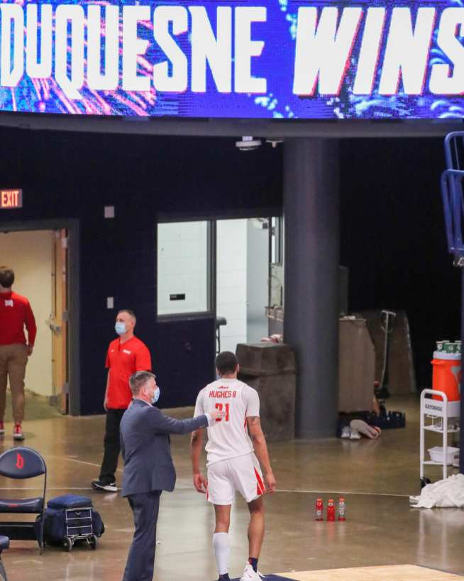 Michael Hughes (21) walks off the court after a Duquesne win February 27, 2021 - Photo by David Hague/PSN