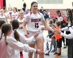 Laia Sole (13) high fives some young fans after first round win in the A10 tournament March 3, 2020 - David Hague/PSN