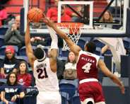 Michael Hughes (21) gets the rebound March 2, 2019 -- David Hague/PSN