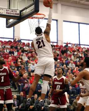 Michael Hughes (21) with the dunk March 2, 2019 -- David Hague/PSN