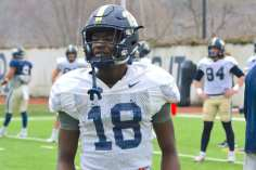 Shocky Jacques-Louis in Pitt's old practice uniforms.