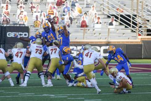 Oct. 10, 2020; Chestnut Hill, Massachusetts, USA; Pittsburgh Panthers defensive linemen Patrick Jones II (91) and Rashad Weaver (17) attempt to block a Boston College Eagles place kicker Aaron Boumerhi (41) kick during an ACC matchup between Pittsburgh and Boston College. The Eagles won the game 31-30 in overtime over the Panthers. Credit © Brian Foley for Foley-Photography.