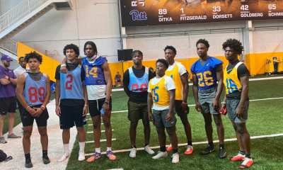 Eight players from Playmakers Academy pose for a picture at Pitt football's recruitment camp.