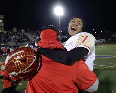 Corey Thomas Jr. (7) celebrates with head coach Jon LeDonne November 23, 2018 — BEN BAMFORD