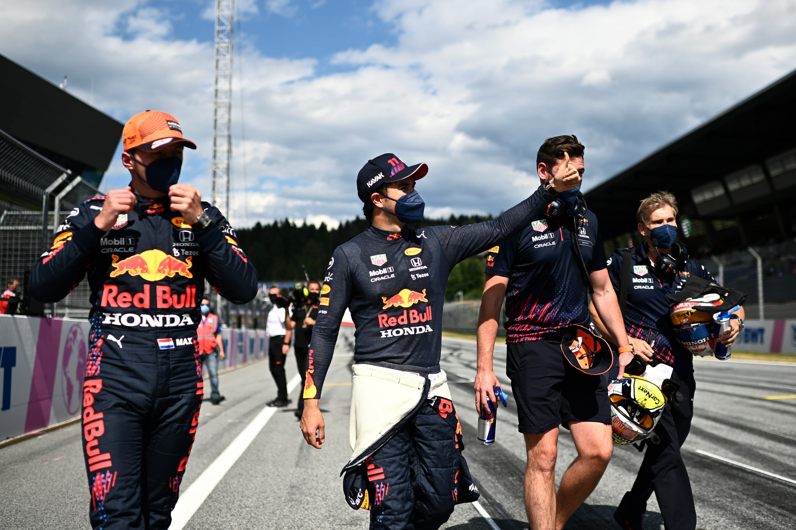 SPIELBERG, AUSTRIA - JULY 03: Pole position qualifier Max Verstappen of Netherlands and Red Bull Racing and third place qualifier Sergio Perez of Mexico and Red Bull Racing celebrate in parc ferme during qualifying ahead of the F1 Grand Prix of Austria at Red Bull Ring on July 03, 2021 in Spielberg, Austria. (Photo by Christian Bruna - Pool/Getty Images) // Getty Images / Red Bull Content Pool  // SI202107030384 // Usage for editorial use only //