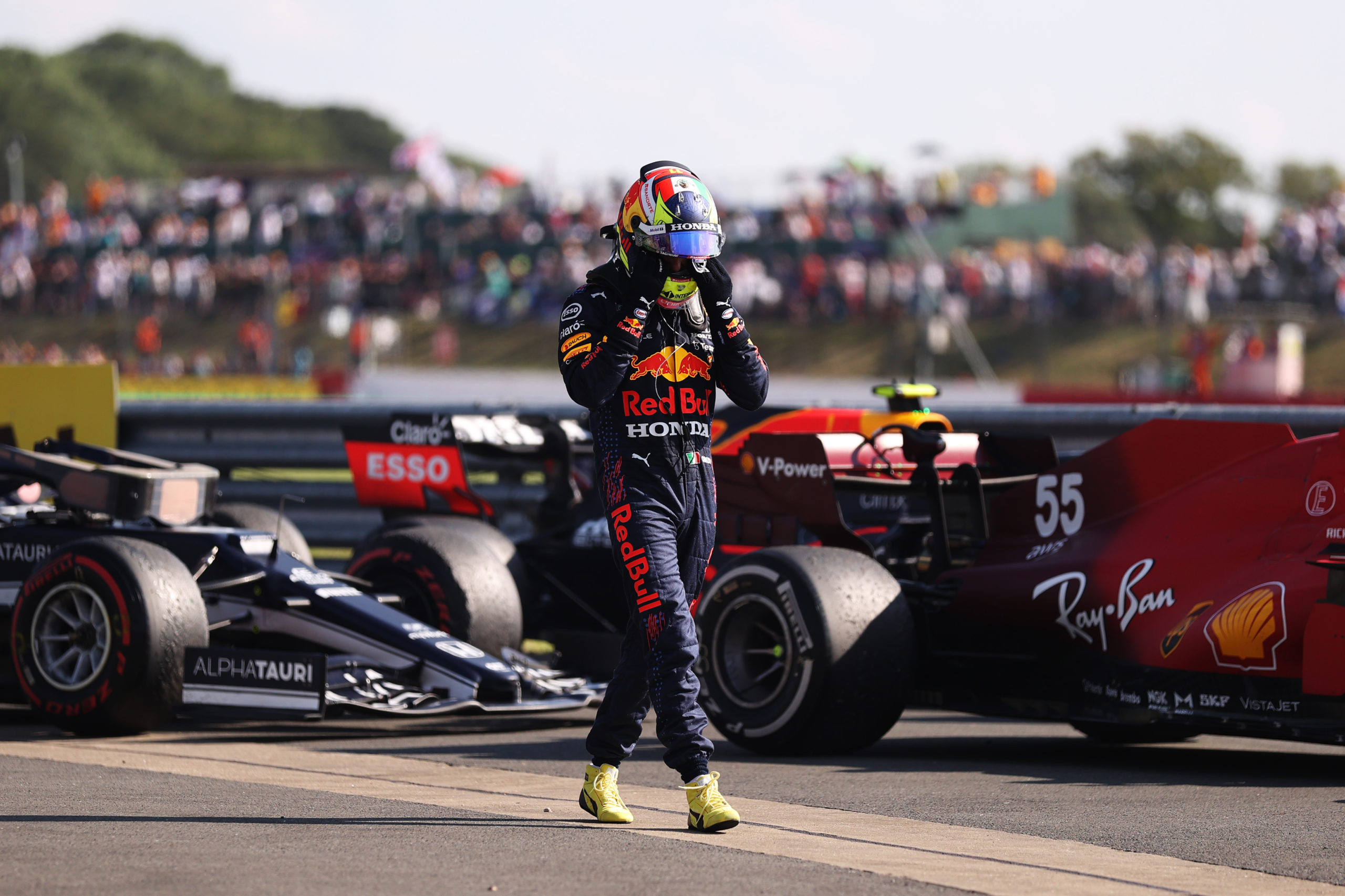 NORTHAMPTON, ENGLAND - JULY 18: Sergio Perez of Mexico and Red Bull Racing walks in parc ferme during the F1 Grand Prix of Great Britain at Silverstone on July 18, 2021 in Northampton, England. (Photo by Lars Baron/Getty Images) // Getty Images / Red Bull Content Pool  // SI202107180273 // Usage for editorial use only //