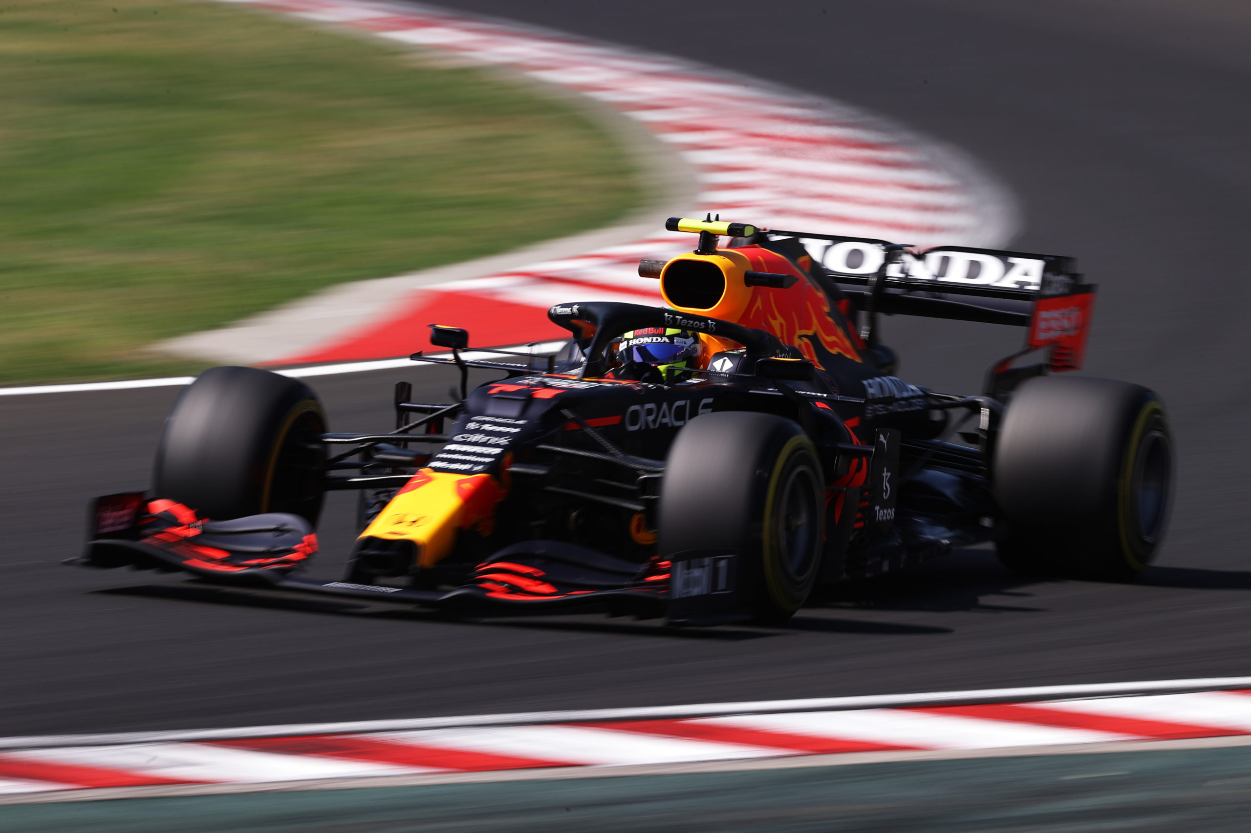 BUDAPEST, HUNGARY - JULY 30: Sergio Perez of Mexico driving the (11) Red Bull Racing RB16B Honda during practice ahead of the F1 Grand Prix of Hungary at Hungaroring on July 30, 2021 in Budapest, Hungary. (Photo by Lars Baron/Getty Images) // Getty Images / Red Bull Content Pool  // SI202107300257 // Usage for editorial use only //
