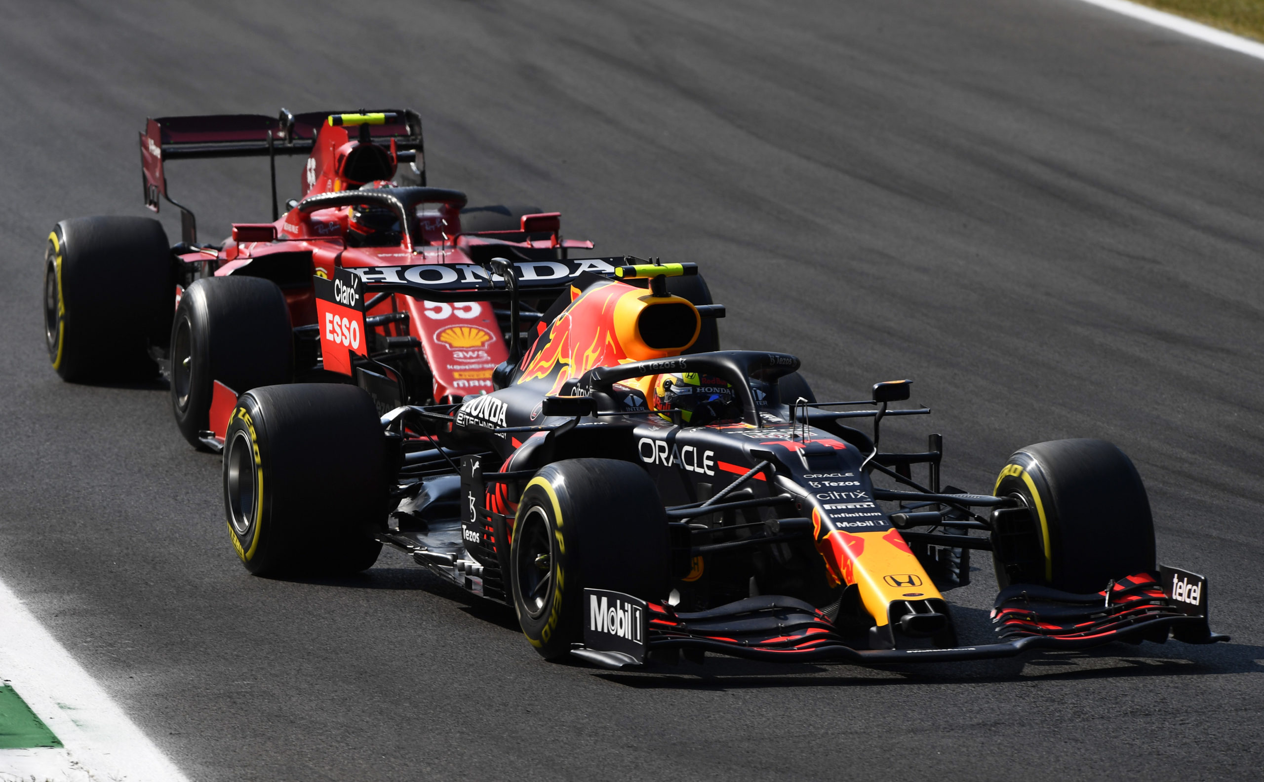 MONZA, ITALY - SEPTEMBER 12: Sergio Perez of Mexico driving the (11) Red Bull Racing RB16B Honda leads Carlos Sainz of Spain driving the (55) Scuderia Ferrari SF21 during the F1 Grand Prix of Italy at Autodromo di Monza on September 12, 2021 in Monza, Italy. (Photo by Rudy Carezzevoli/Getty Images) // Getty Images / Red Bull Content Pool  // SI202109120260 // Usage for editorial use only //