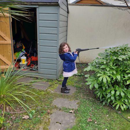 "Georgina JI Ms. Goss ""Pressure washing the garden wall!"""
