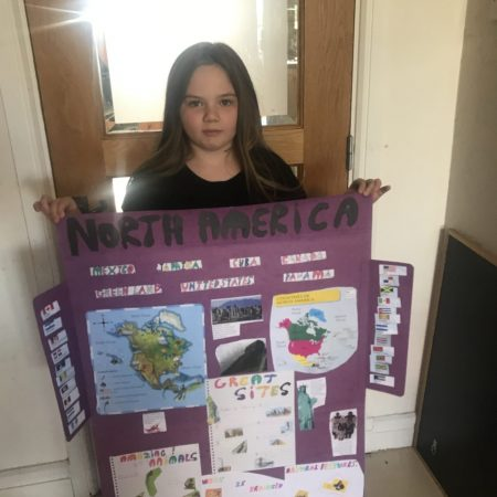 """Grainne with some of her project on the continents of the world"""" 2nd Mr Neary """""""