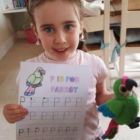 """Isabel JI Ms McCarthy """"Practicing the letter P with my parrot Maura"""""""