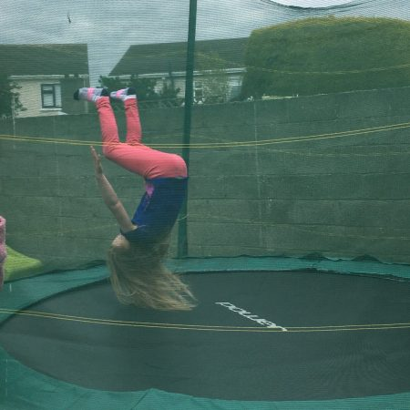Molly Sr Inf Ms Godson practices back flips on the trampoline!