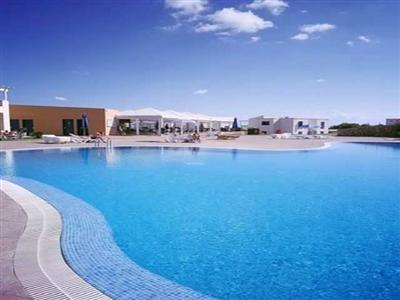 Offering mountain biking, diving and volleyball onsite, the property boasts comfortable rooms along with cots, high chairs and a children's club for children. Apartamentos Primasud In Menorca, Spain