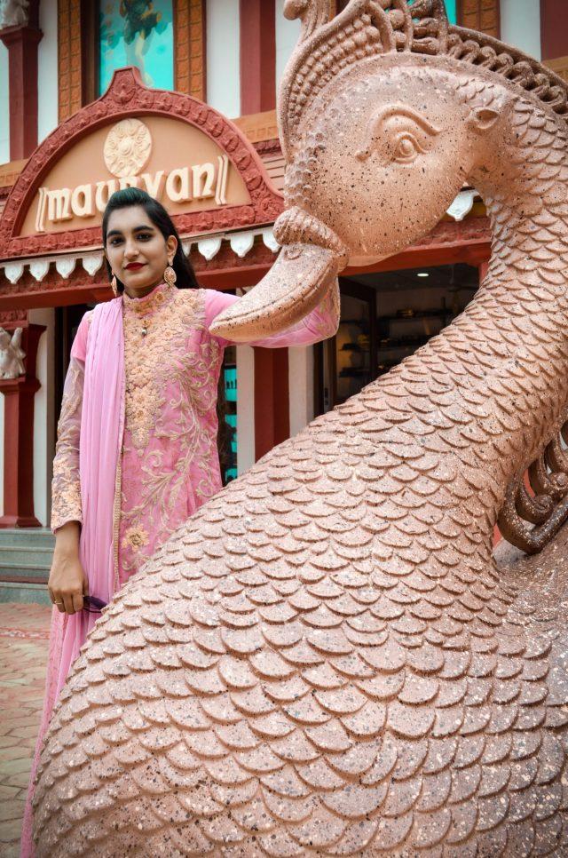 A woman posing in ethnic wear