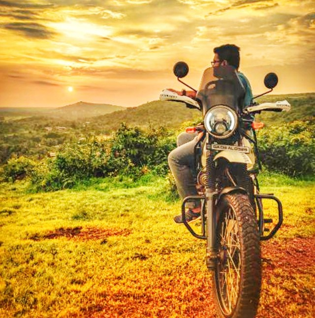 Man sitting on a motorcycle,