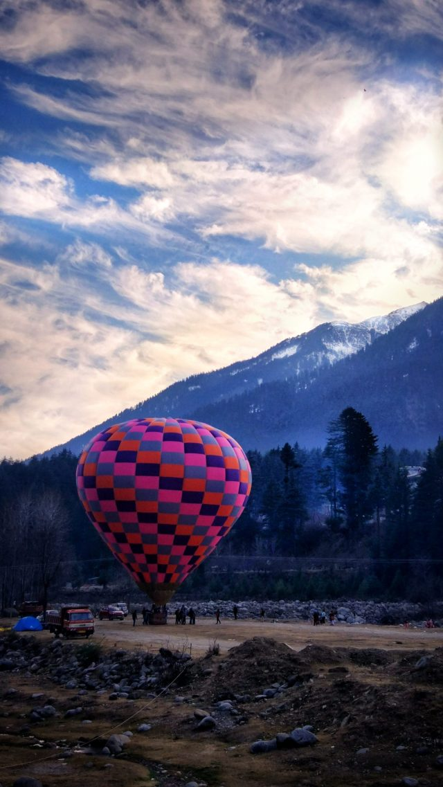 People enjoying a ride in hot air balloon.
