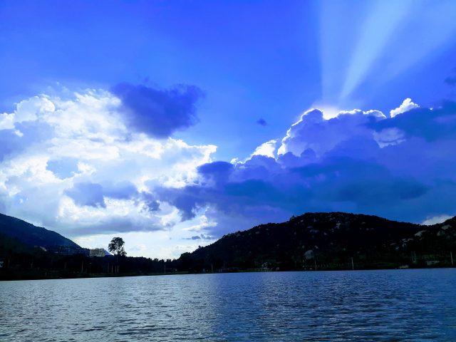 Summer sunset through a lake
