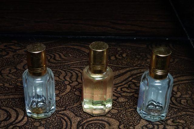 Three perfume bottles on a table