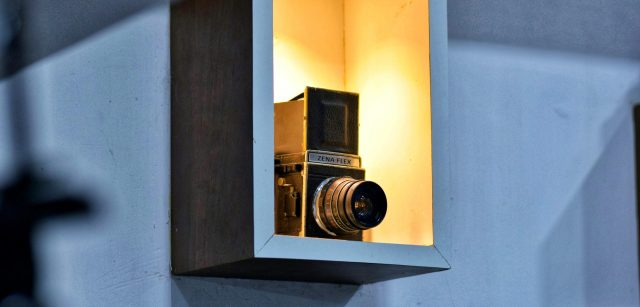 A vintage camera placed in a room