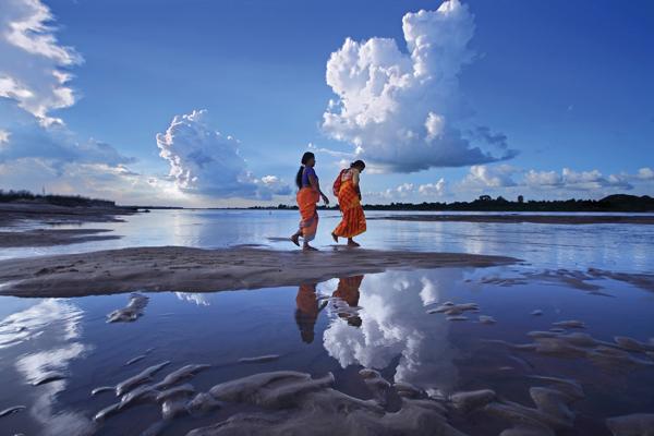 Walking on dried Damodar river of West Bengal