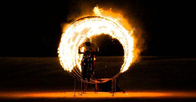 A biker passing through ring of fire
